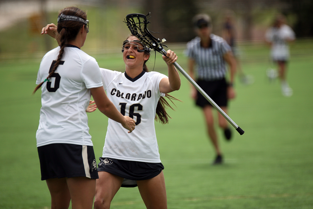 Colorado freshman attacker/midfielder Cali Castagnola (5) celebrates with teammate Johnna Fusco (16) after Castagnalo scored a goal during a women's lacrosse game between Colorado and California, Sunday, April 20, 2014, at Kittredge Field in Boulder, Colo. The Buffs lost 6-7. (Kai Casey/CU Independent FIle)