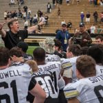 Colorado head coach Mike MacIntyre speaks to the Buffs prior to the 2014 Spring Game April 13, 2014. (Matt Sisneros/CU Independent File)