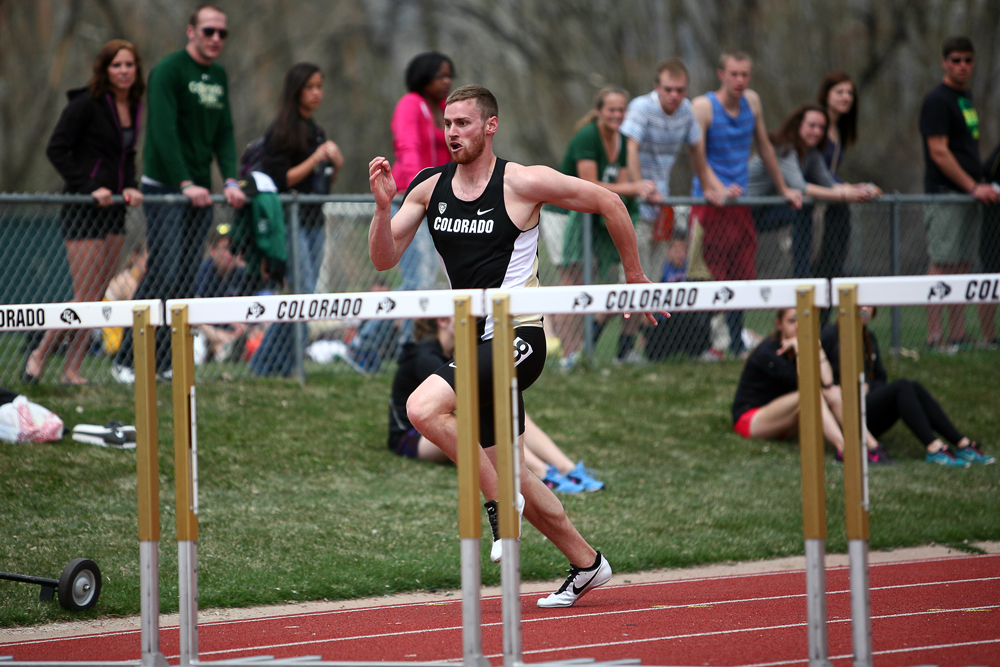 Tyler Dewitt of Colorado sprints on his way to winning his heat in the men's 100 meter hurdles during the Colorado Invitational Track and Field Meet, Saturday, April 12, 2014, at Potts Field in Boulder, Colo. (Kai Casey/CU Independent File)