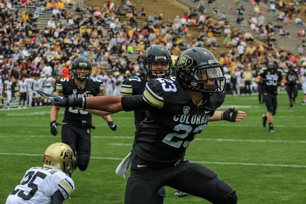 Ahkello Witherspoon celebrates after his game-clinching broken-up pass during the Spring Game on Saturday at Folsom Field in Boulder, Colo. (Matt Sisneros/ CU Independent)
