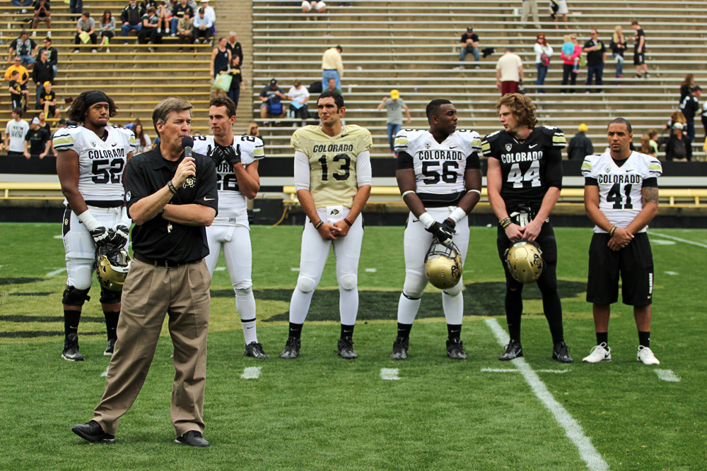 Head coach Mike MacIntyre introduces the five captains for the upcoming season: senior offensive lineman Daniel Munyer (52), junior wide receiver Nelson Spruce (22), freshman quarterback Sefo Liufau (13), senior defensive lineman Juda Parker (56), freshman linebacker Addison Gillam (44), and senior safety, Terrel Smith (41) during the Spring Game, April 12, 2014, in Boulder, Colo. (Matt Sisneros/CU Independent)