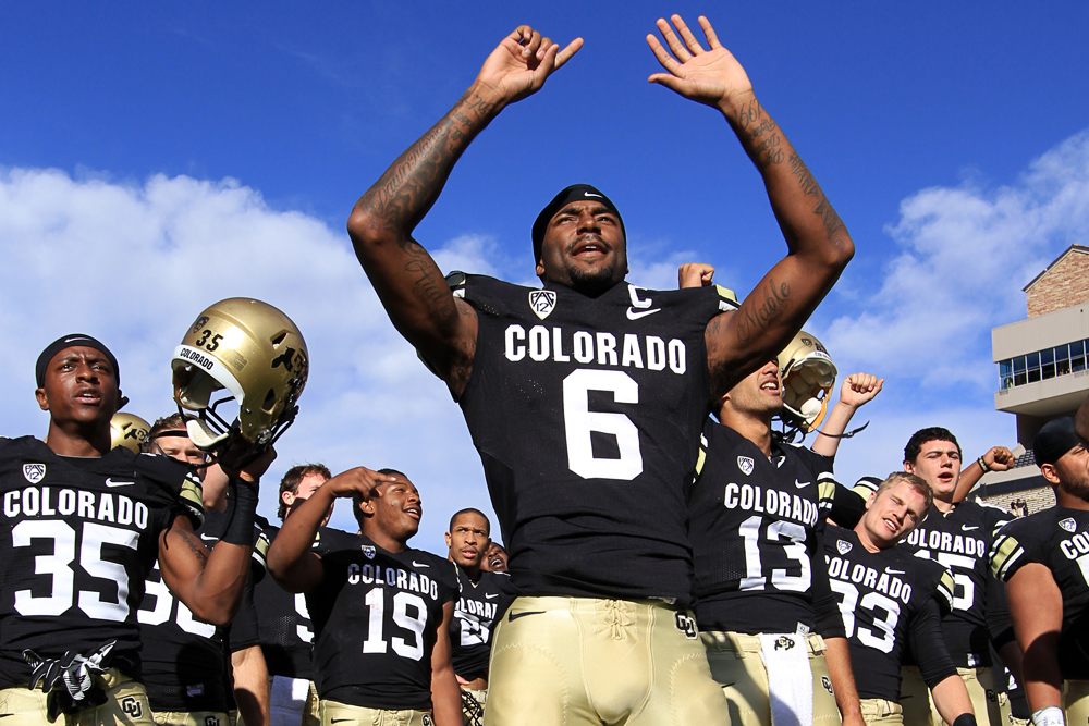 Paul Richardson celebrates with his team after the Buffs 43-10 win over Charleston Southern, Oct. 19, 2013. CUI sportswriter Tommy Wood predicts that Richardson will go in the NFL Draft. (Nigel Amstock/CU Independent)