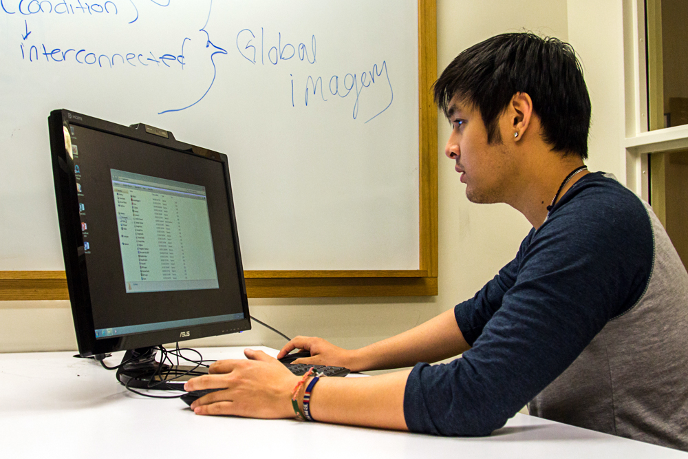Sophomore business minor Toto Snidvongs, works in a study room in the Koelbel Library. (Matt Sisneros/CU Independent)