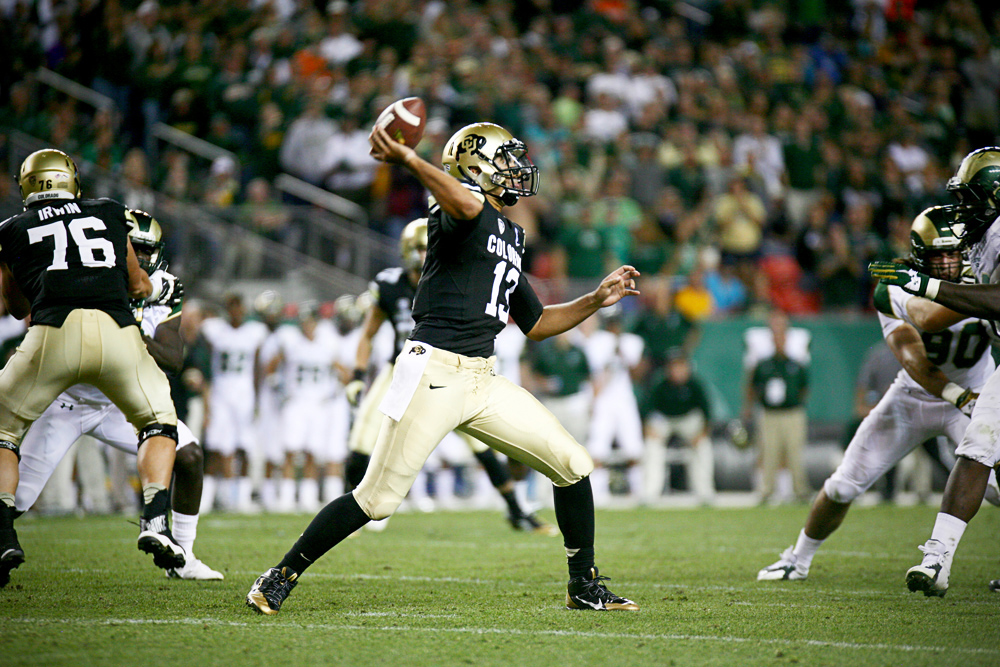Colorado quarterback Sefo Liufau finds an open receiver during the first half of the 2014 Rocky Mountain Showdown. Liufau finished the game with 241 yards passing and two touchdowns. (James Bradbury/CU Independent)
