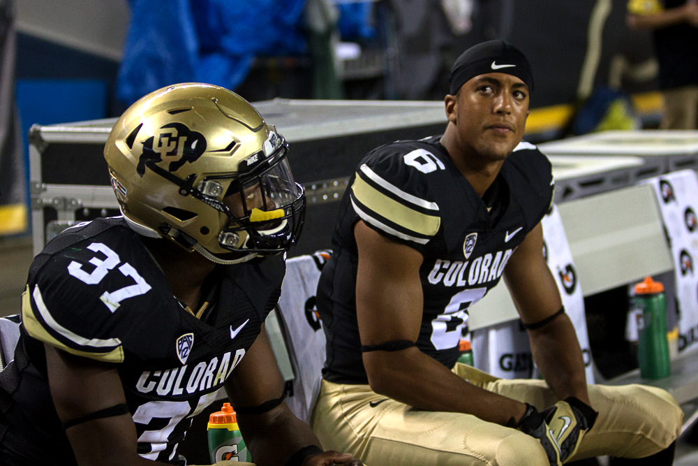 Freshman defeinsve back Evan White and senior linebacker Woodson Greer III watch the final seconds tick away and confirm a 31-17 Buffs' loss during Friday's game against CSU. This week, CU Independent writers discuss the future of Colorado's season. (Matt Sisneros/CU Independent)