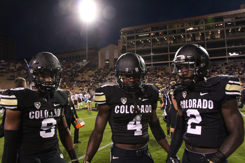 Colorado's Tedric Thompson (9), Chidobe Aquzie (4) and Kenneth Crawley (2) mug for the camera in their all-black helmets just before kickoff. (Gray Bender/CU Independent File)
