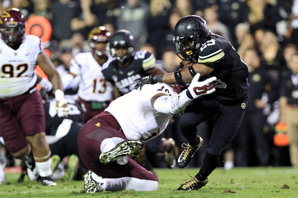Colorado wide receiver Donovan Lee (29) sheds a would-be Arizona State tackler during the Saturday night loss to Arizona State on Sept. 14, 2014 (Nigel Amstock/CU Independent File)