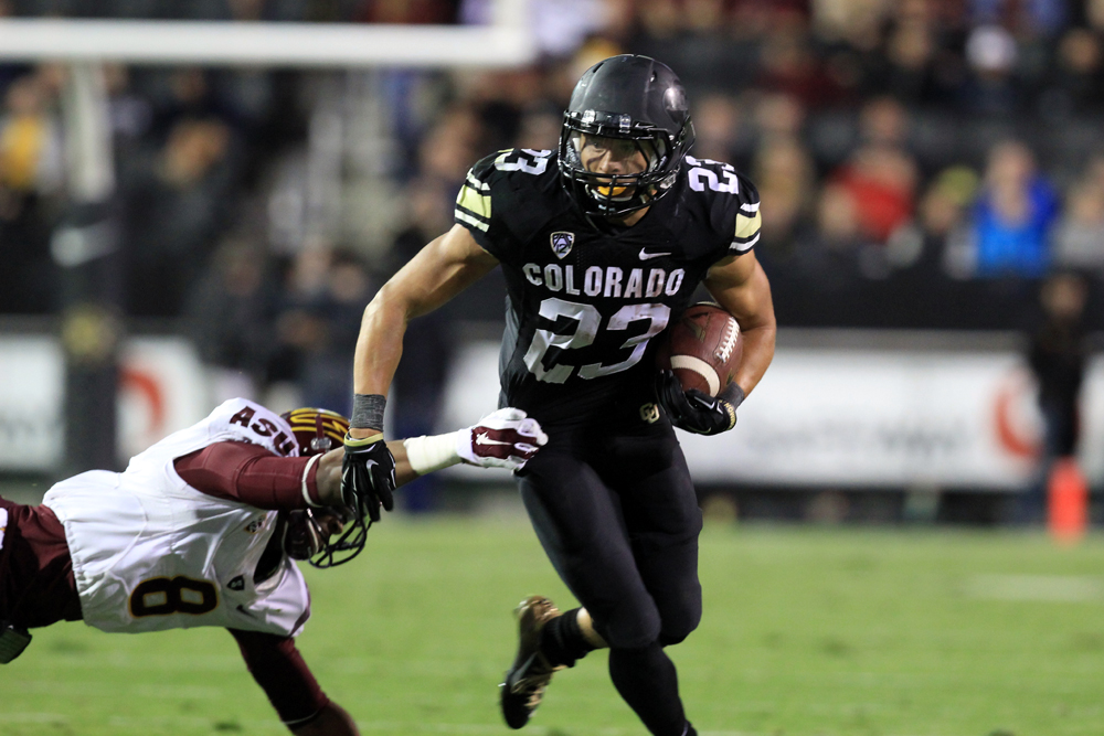 Colorado freshman tail back Phillip Lindsay (23) sheds Arizona State's Lloyd Carrington (8). (Nigel Amstock/CU Independent File)
