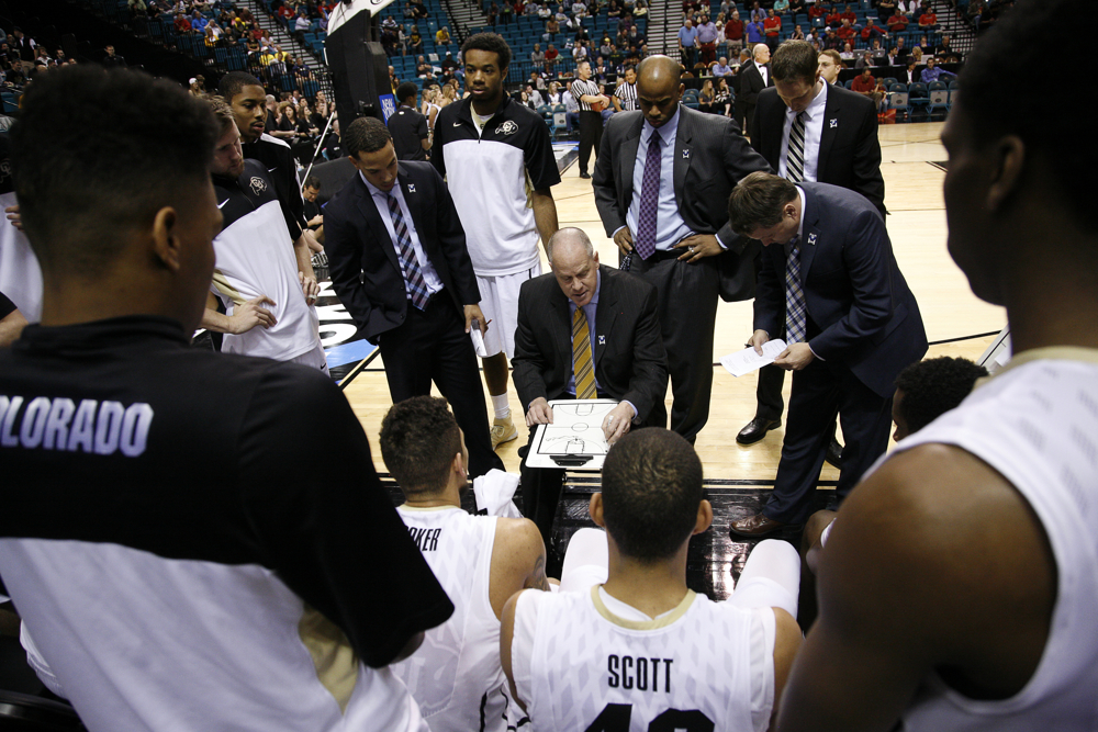 Colorado head coach Tad Boyle talks to his team during a timeout of a first-round Pac-12 Tournament game between Colorado and Southern California on Wednesday, March 12, 2014, at the MGM Grand Garden Arena in Las Vegas, Nev. (Kai Casey/CU Independent)
