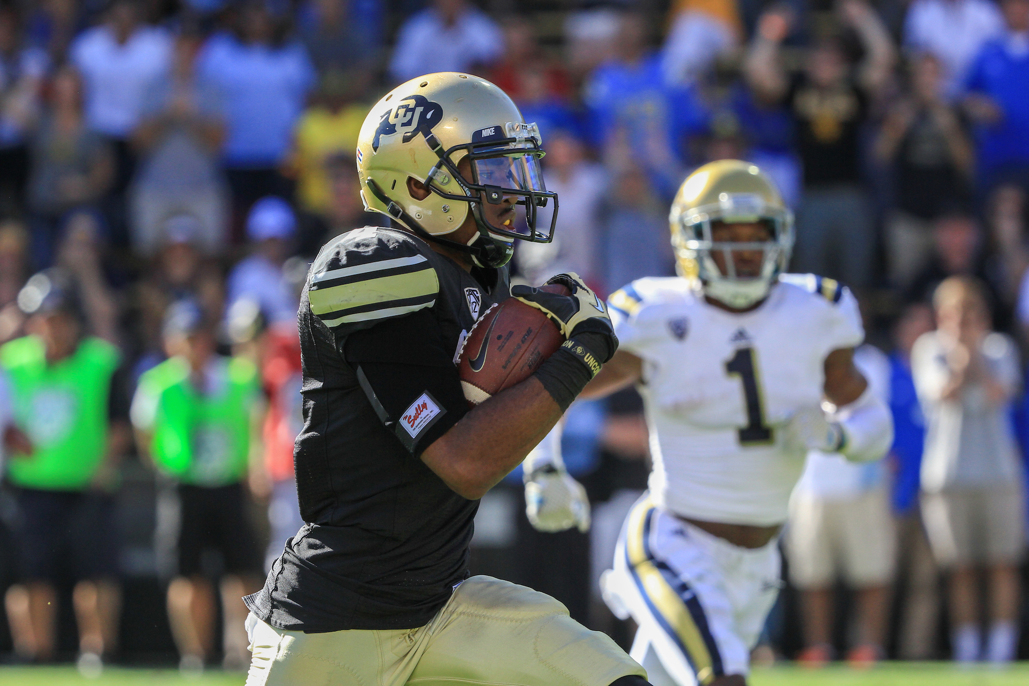 Wide receiver Bryce Bobo breaks away for a touchdown in the 4th quarter of play against UCLA on Oct. 25 2014. The Bruins beat the Buffs 40-37 in 2OT. (Nigel Amstock /CU Independent File)