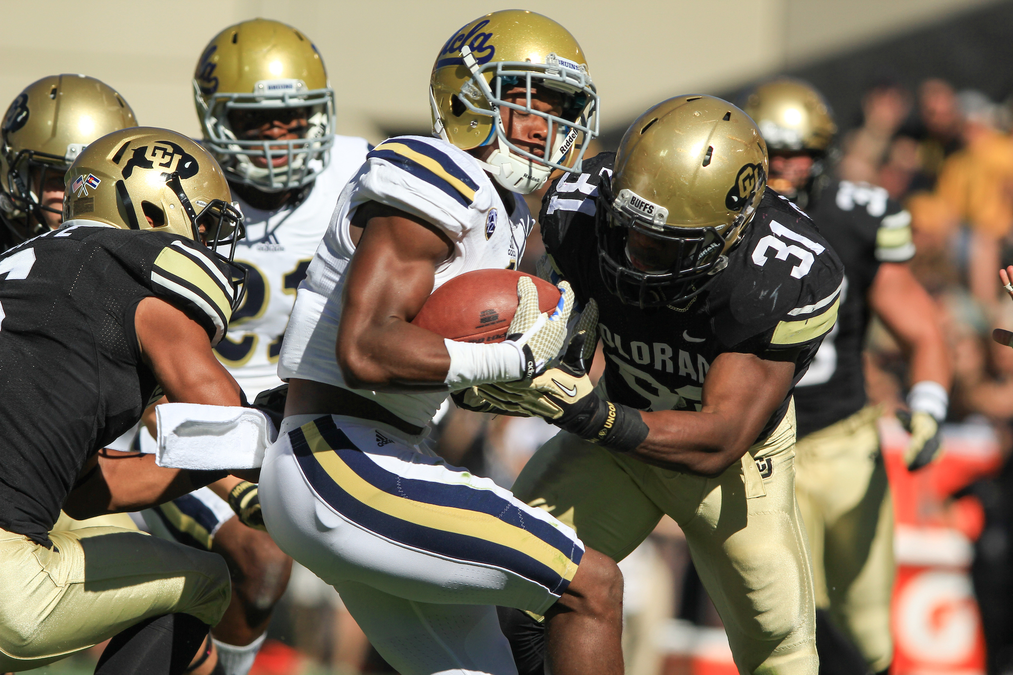 Then-sophomore linebacker Kenneth Olugbode tackles a UCLA ball carrier on Oct. 25, 2014 at Folsom Field. (Nigel Amstock/CU Independent File)