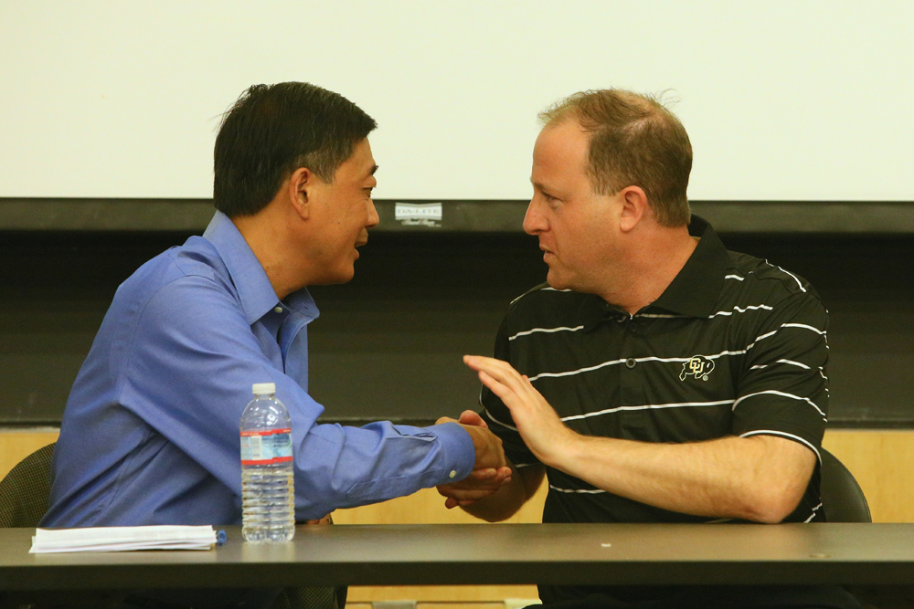 Congressman Jared Polis and Republican challenger George Leing shake hands following their debate in Humanities 150 on Tuesday night. (Nigel Amstock/CU Independent)