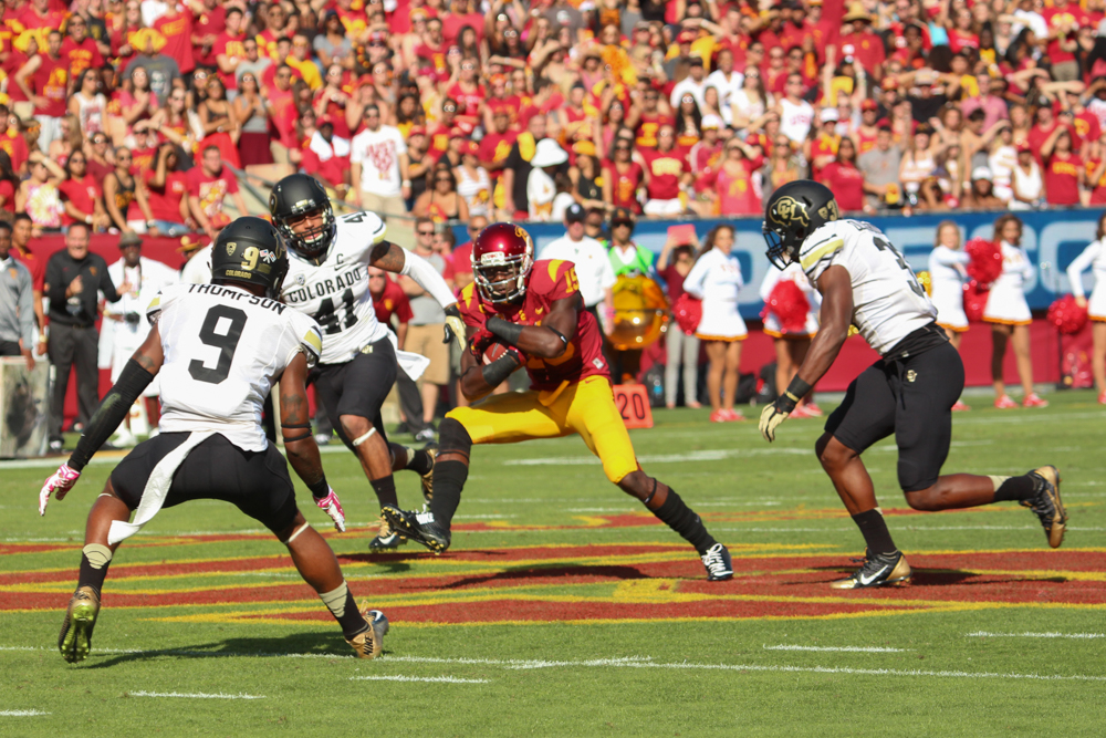 USC wide receiver Nelson Agholor dodges the CU defense at the Los Angeles Coliseum in Oct. 2014. (Gray Bender/CU Independent File)