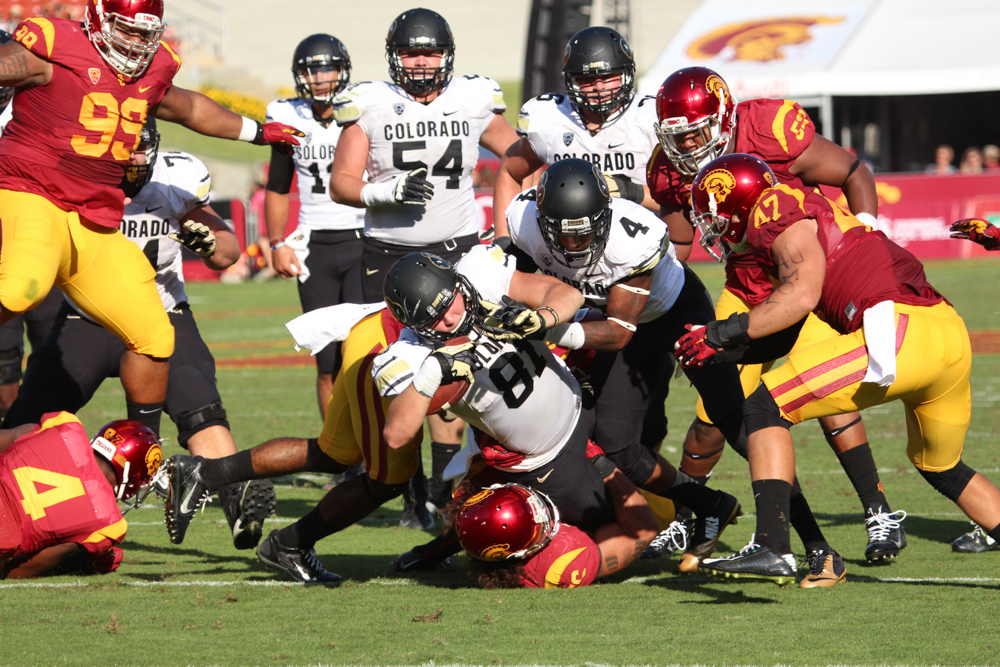 Tight end Sean Irwin (81), sophomore, battles through the USC defensive line at the Coliseum. Oct. 19, 2014 (Gray Bender/CU Independent File)