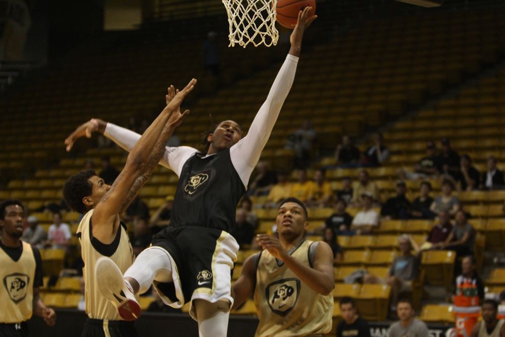 Junior Xavier Johnson fights his way to the basket against fellow Buffs during the scrimmage on Saturday. (Gray Bender/CU Independent)