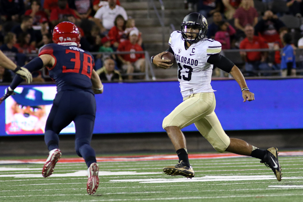 Quarterback Sefo Liufau scrambles for yardage late in the first quarter of play against the Arizona Wildcats on Nov. 8, 2014. The Wildcats defeated the Buffs 38-20. (Nigel Amstock/CU Independent File)