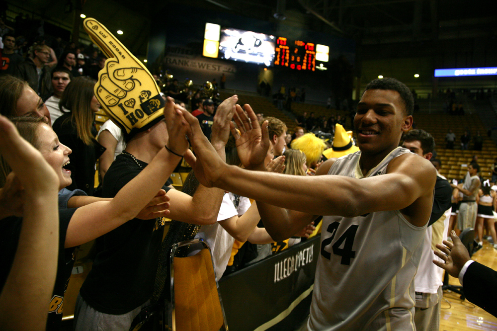 George King (24) high-fives fans after defeating Wyoming during the 2013-14 season his freshman year. During today's media day,  coach Tad Boyle announced that King will redshirt this 2014-2015 season. (Kai Casey/CU Independent)