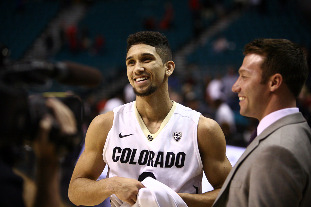 Colorado junior guard Askia Booker (0) is interviewed by a Pac-12 Networks reporter after a first-round Pac-12 Tournament game in 2014. (Kai Casey/CU Independent)