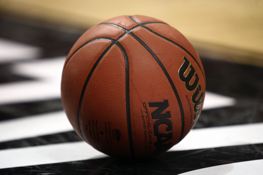 A Pac-12 basketball sits on the court during a semifinal Pac-12 Tournament game. March 14, 2014. (Kai Casey/CU Independent File)