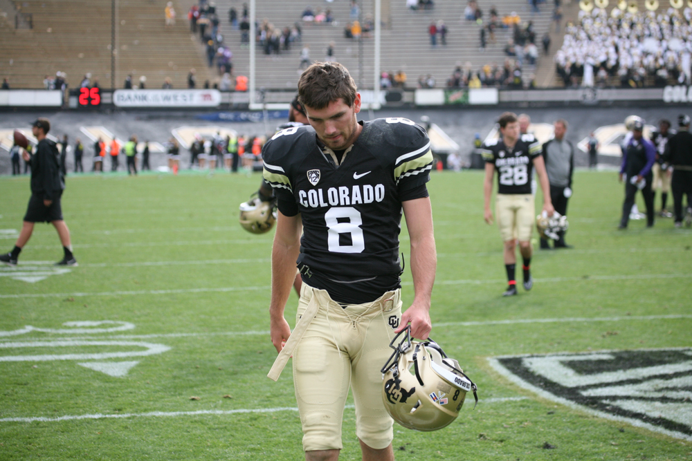 Punter Darragh O'Neill walks off the field after the tough loss to Washington on Saturday Nov. 1, 2014. (Gray Bender/CU Independent File)