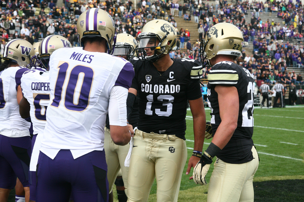 Quarterback Sefo Liufau shakes hands with Washington's captains prior to a game at Folsom Field on Nov. 1, 2014 (Matt Sisneros/CU Independent)