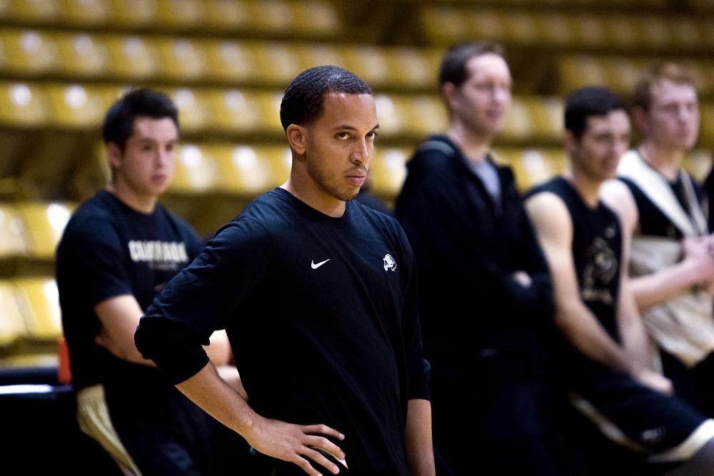 Assistant coach Rodney Billups watches players run through drills during practice. (Matt Sisneros/CU Independent)