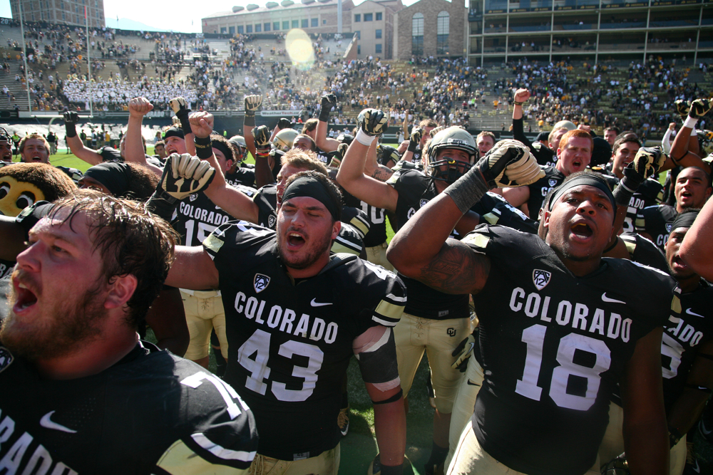 Colorado freshman fullback George Frazier (18) and senior inside lne backer Brady Daigh (43) sing the fight song with their teammates after beating Hawaii during an NCAA football game between the Colorado Buffaloes and the Hawaii Rainbow Warriors, Saturday, Sept. 20, 2014, at Folsom Field in Boulder, Colo. The Buffs won 21-12, getting their first home win of the season. (Kai Casey/CU Independent)