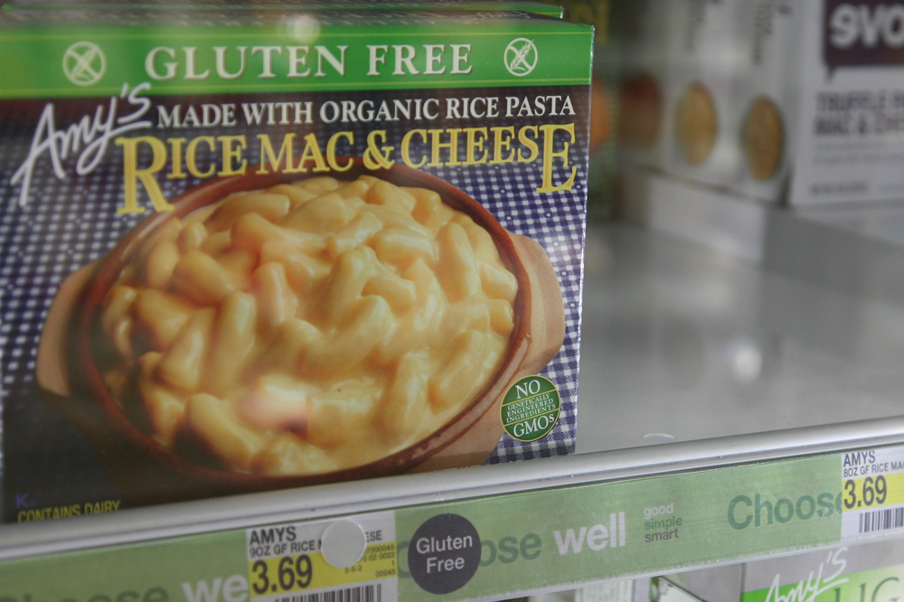 """A box of Amy's Mac & Cheese sits in the refrigerated aisle at the Target on Pearl Street. Amy's Kitchen supports non-GMO food and proudly displays their green label """"No Genetically Engineered Ingredients"""" on the bottom right corner of their boxes. (Jade Lang/CU Independent)"""