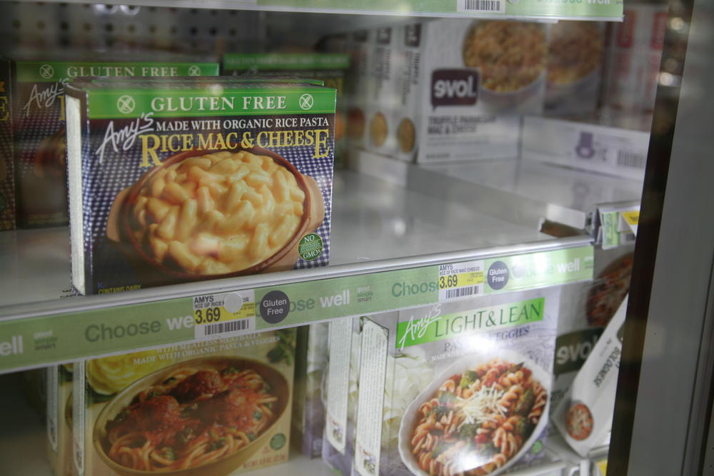 "A box of Amy's Mac & Cheese sits in the refrigerated aisle at the Target on Pearl Street. Amy's Kitchen supports non-GMO food and proudly displays their green label ""No Genetically Engineered Ingredients"" on the bottom right corner of their boxes. (Jade Lang/CU Independent)"