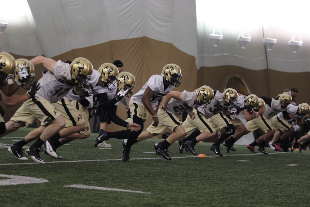 The Buffs football team practices in the varsity sports bubble before their 2014 season than ended with only two victories out of a total of twelve games. (Matt Sisneros/CU Independent)
