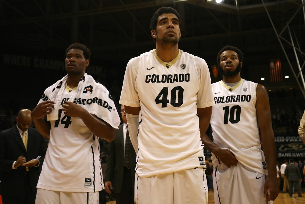Tory Miller, Josh Scott and Tre'Shaun Fletcher display a somber look folowing the Buffs 82-54 loss to the Arizona Wildcats. Feb 26 2015. (Nigel Amstock/CU Independent File)
