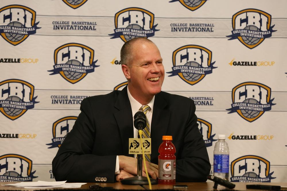 Colorado Head Coach Tad Boyle speaks to the press with a large smile following Colorado's 87-78 victory over the Gardner-Webb Runnin' Bulldogs in the first round of the College Basketball Invitational tournament March 2015. (Nigel Amstock/CU Independent)