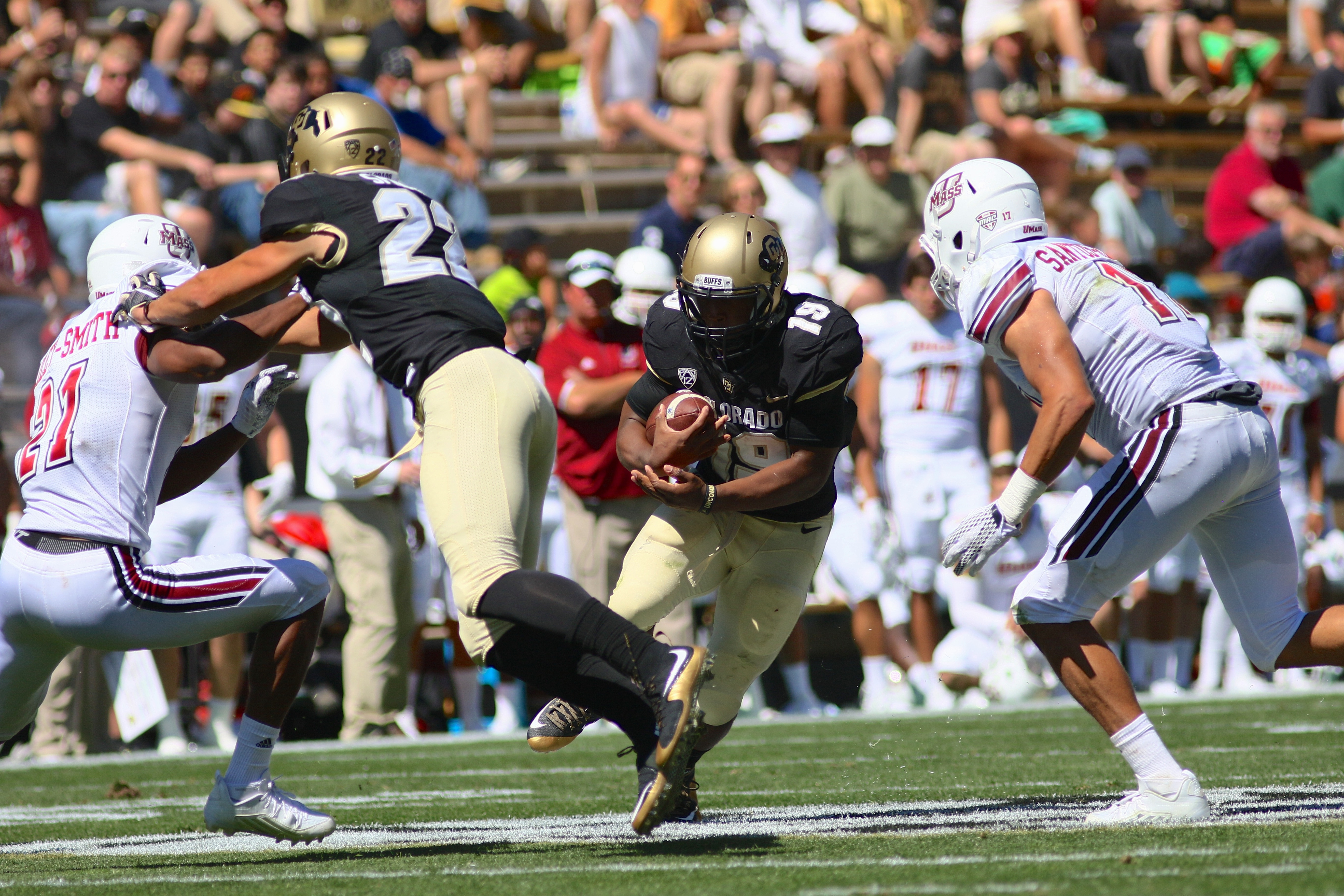Junior RB Michael Adkins II looks to exploit a gap in the UMass defence during the second quarter of play at Folsom Field. (Nigel Amstock/CU Independent)