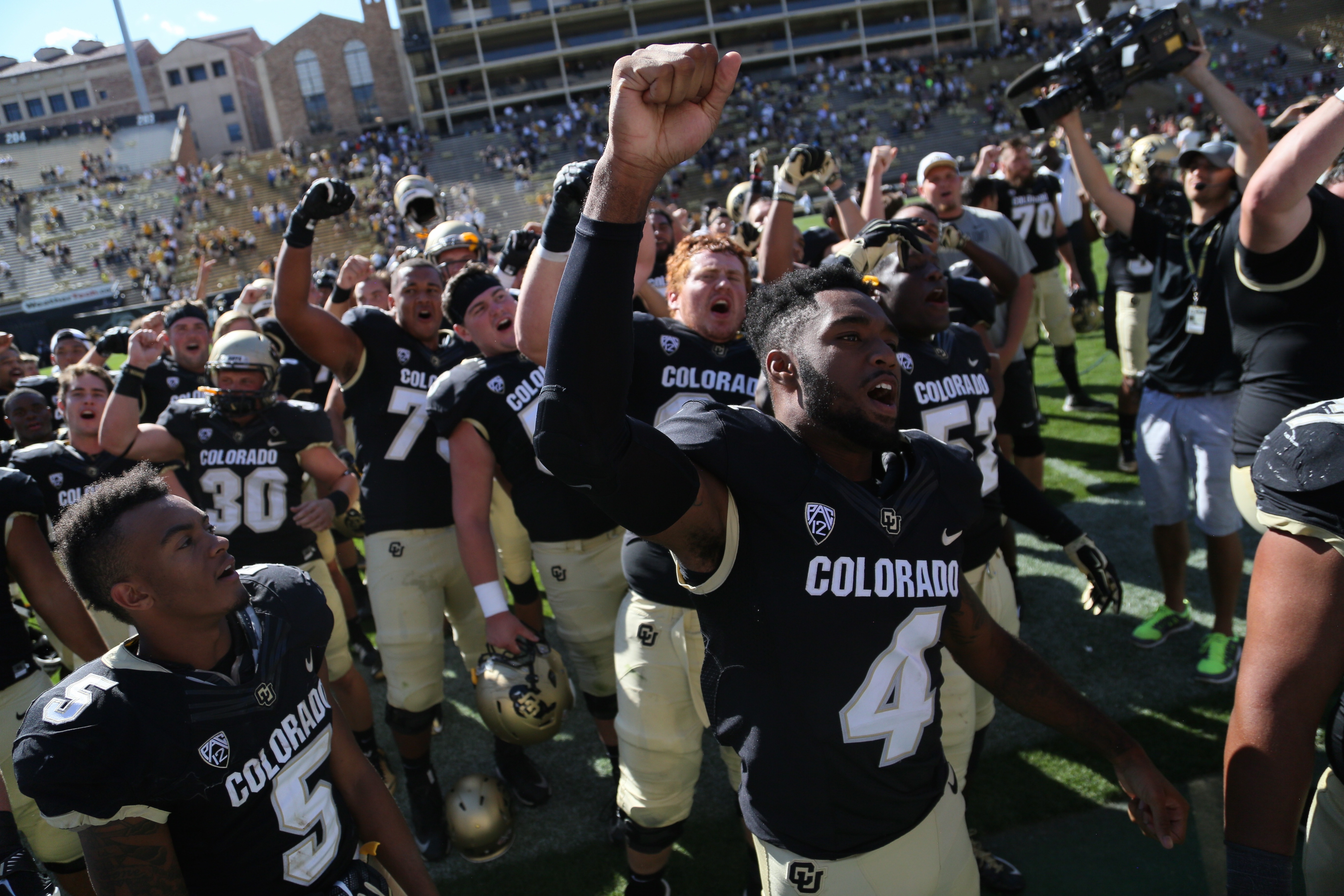 The Buffs celebrate their 48-14 victory over the UMass minutemen at Folsom Field. (Nigel Amstock/CU Independent)