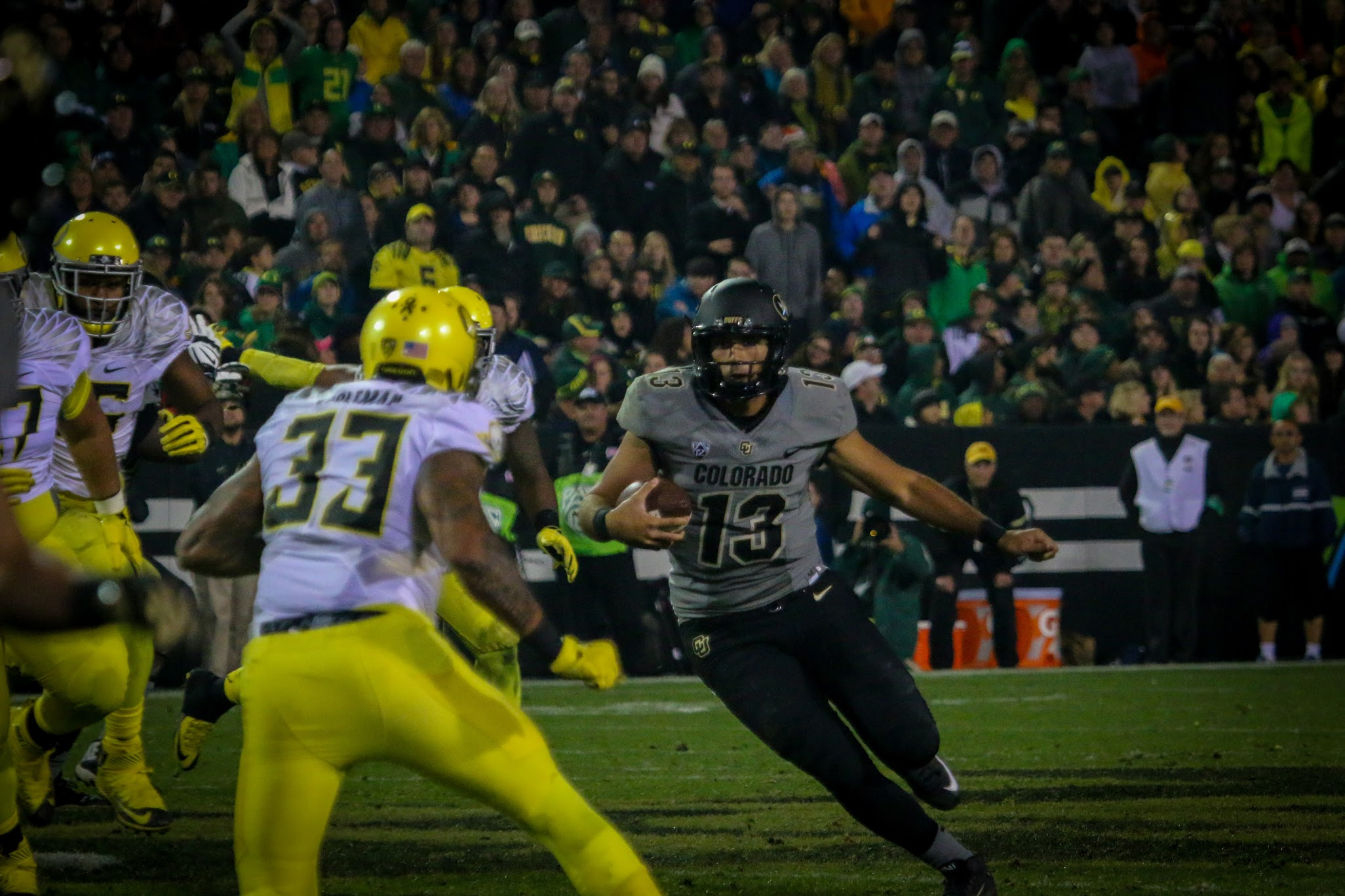 Then-junior quarterback Sefo Liufau rushes the ball into the end zone for his first rushing touchdown of the season during the Buffs' 41-24 loss to the Oregon Ducks at Folsom Field on Saturday, Sept. 4, 2015. (Robert Hylton/CU Independent file)
