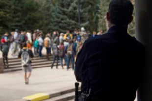 Police looking on at the crowd of students being preached at by extremist Christians at the Dalton Trumbo Fountain, campus' dedicated free speech zone. (Vincent Guielo/CU Independent)