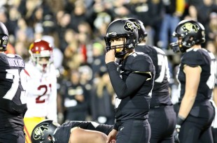 Freshman QB Cade Apsay inserts a mouth guard shortly after replacing  Sefo Liufau, who left the game with a foot injury. Nov. 13 2015. (Nigel Amstock/CU Independent File)