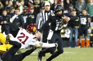 Freshman QB Cade Apsay looks to evade a sack early in the forth quarter of play at Folsom Field Nov. 13, 2015. (Nigel Amstock/CU Independent)