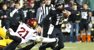 Freshman QB Cade Apsay looks to evade a sack early in the forth quarter of play at Folsom Field on Nov. 13 2015. (Nigel Amstock/CU Independent)