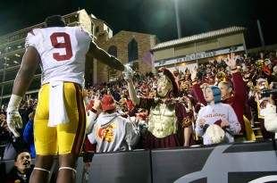 Trojan reciever JuJu Smith hands a sword to Trojan mascot Tommy the Trojan, following USC's 27-24 victory over the Colorado Buffaloes at Folsom Field. Nov. 13 2015 (Nigel Amstock/CU Independent)