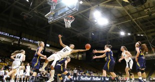Senior forward Jamee Swan attempts to maintain possession of the ball during the fourth quarter of play against the UNC Bears at the Coors Events Center Nov. 19, 2015. (Nigel Amstock/CU Independent File)