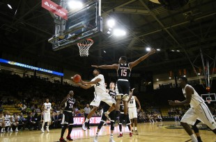 Sophomore guard Dominique Collier elevates for a layup during the final minutes of play at the Coors Event Center. Collier recorded thirteen points against the Omaha Mavericks. Nov. 22, 2015 (Nigel Amstock/CU Independent)