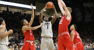 Junior forward Wesley Gordon looks to shoot the ball between two Ute defenders at the Coors Events Center on Jan. 8, 2016. (Nigel Amstock/CU Independent)
