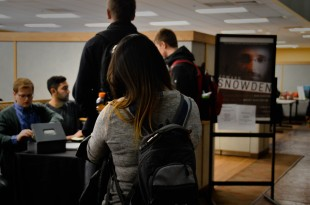 """Students wait in line to buy tickets to """"An Evening With Edward Snowden"""" Feb 2, 2016 (Molli Nava/CU Independent)"""