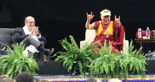 "His Holiness the Dalai Lama makes the ""I love you"" sign in sign language during his talk titled ""Educating the Heart and Mind"" at the Coors Events Center. June 23, 2016. (Nigel Amstock/CU Independent)"