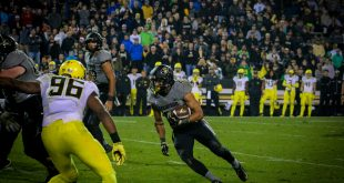 Sophmore running back Phillip Lindsay powers the ball through the Oregon Ducks defense during the Buffs' 41-24 loss at Folsom Field on Saturday, Sept. 4, 2015. (Robert Hylton/CU Independent)