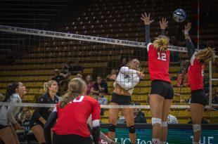 Sophomore Alexa Smith spikes the ball during the Buffs' 2-3 loss to the Utah Utes on Wednesday, Sept. 21, 2016. (Robert Hylton/CU Independent)