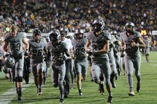 Buffs return to the locker room for half time. (Maddie Toretto/CU Independent)