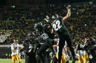 Celebration occurs as Spruce scores the first touchdown of the night for CU. Folsom Field on Nov.13th, 2015. (Will McKay/CU Independent)
