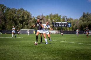 The CU women's team fought with an opponent for possession for the ball. (Robert Hylton /CU Independent)
